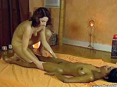 Two sexy lesbians are having wild massage session. One is giving her partner a relaxing oily rubbing down her tight ebony pussy!