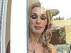 Blonde haired, Tanya Tate is a big boobed MILF, who gives you an upskirt of her completely shaved snapper and tattoo while she's rubbing her clitoris and getting screwed by her nephew's best friend. She bends over an lets him poke his prick into her twat while you get a close up of her tight asshole, before he shoots his load on her tits.