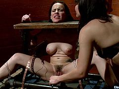 A pillory is used to dominate this girl and make her lick pussy and reach an orgasm by toying her cunt. It's lesbian femdom at its best.