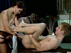 Bobbi Starr is going to strapon fuck a guy in this femdom video where she shows him who the boss really is.