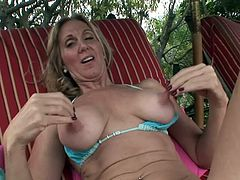 A mature woman gets naked, spreads her legs and starts fingering and rubbin' her tight pink pussy, check it out right here!