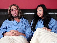 Keiran Lee is playing John Lennon and Gia Grace is playing Yoko Ono. They both get into bed with each other after recoding in the studio and Gia pulls her pyjamas off to reveal her tight, sexy leotard. She waves her crotch in front of his face and he rubs her vagina with his fingers.
