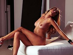 Check out the incredibly sexy blonde babe Anna Beletzki as she takes off her bikini to show her perfect body, tiny waist and shaved pussy.