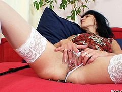 Naughty mature bitch from Czech Republic pleases her pussy in solo. She explores her snatch with her playful fingers and plays with her saggy tits.