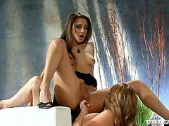Carli Banns and Celeste Star take their dresses off and lick each others pussies in close-up scenes. After that they also use pink dildo to make it better.