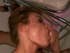 Voluptuous MILF with huge silicon boobs is tied up to the massage couch so she is not able to make a move that is not agreed with her master. He butt plugs her in this position probing her ass deep. She screams like crazy feeling pain and pleasure at a time. He bangs her hard until she cums.