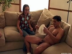 nerdy girl jacks off a naked guy
