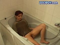 Cute brunette gives her sex partner eager blowjob and later he pisses on her T-shirt in the bath. Go fro the kinky sex tube video produced by 21 Sextury porn site.