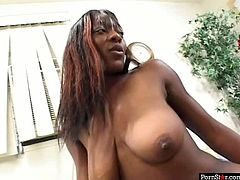 Nasty ebony chick rides dick reverse and you can enjoy her saggy boobs bounce like crazy. Later stud dumps all his jizz on her lower back tattoo. It's look hot and exciting.