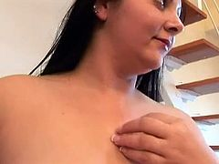 Chubby brunette takes off her closes and shows off her lower back tattoo. Later she sucks dildo toy and spreads her legs wide to satisfy her pussy.