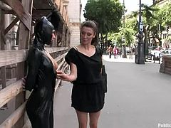 This passionate babe is wearing her latex head harmess and starts seducing dudes for a public sex. But in fact it's just an outdoor sex.