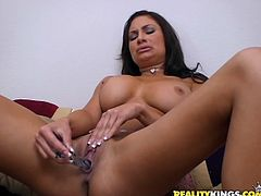 Superb brunette chick takes her lingerie off and fondles her vagina with fingers. Later on she stuffs her pussy with two different dildos.
