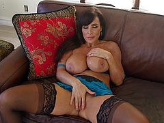 After stroking a huge dick in her sexy mouth, Lisa Ann enjoys swa