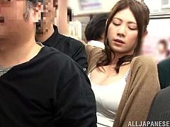 Japanese chick with big boobs and hot ass is in a subway train. She gets her skirt lifted up by some dude. He touches the ass and fondles the pussy through the panties.