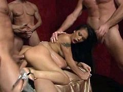 Watch the alluring Asian brunette Luci Thai getting spectacularly gangbanged by 4 horny studs in this amazing video.