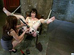 Brunette cutie Natalie is having fun with Princess Donna Dolore indoors. Donna ties Natalie up, attaches wires to her ass and then slams her juicy snatch with a dildo.