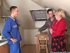 This granny's washing machine got broken, so two young guys came to fix it. They preferred to fuck the granny though.