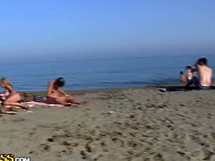 He and his sexy girlfriend are having some wild fucking on the beach. She sucked his dick off and then took it deep inside her tight muff!