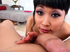 Japanese girl gives a handjob to a guy first. Then she starts to suck his dick and lick balls. After that she gets her face covered with cum in POV video.