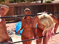 Sexy blonde milfs Phoenix Marie and Sadie Swede go head to head in a outdoor wrestling match. Round two starts in the swimming area where they pull each other's spandex outfits off to show their big tits. They get horny and grab the referee's cock and begin to suck him off.