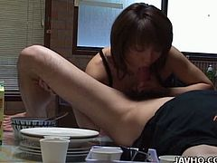 Skillful Japanese prostitute seduces a horny dude right in the kitchen. She makes him lie on the kitchen counter as she clings to his sturdy penis wearing seductive black lingerie to give him a thorough blowjob.