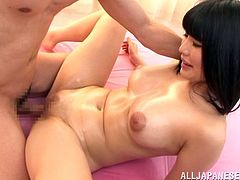 Hot Japanese girl with hot boobs gets undressed and oiled up. Later on she gets fucked in a cowgirl and missionary poses on the floor.