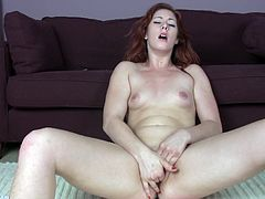 Some lovely redhead chick takes off her clothes and starts fingering her pussy, showing off her piss flaps for the camera.