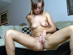 Pretty girl spreads her legs while naked and starts fingering her pink wet pussy for the camera in this amazing solo scene.