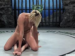 A couple of dirty bitches lay on the ground and begin to fucking wrestle till one of them comes out victorious and fucks the other with a strapon.