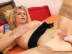 This Blonde Czech is a mature slut who loves being watched as she fucks her old snatch with a vibrator.