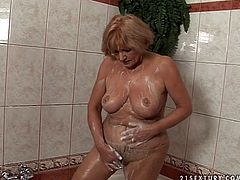 Cum addicted oldie is the owner of huge boobs and enormous butt. This horny bitch takes a shower and then desires to be fed with gooey sperm. So fat whore bows above the old man's dick and sucks it passionately on the wide bed.
