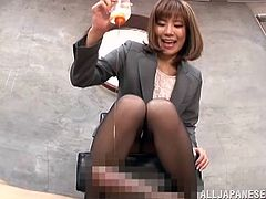 Hot Japanese office girl Suzu Tsubaki is playing dirty games with some dude indoors. She pours oil on his dick and then drives him mad with a terrific footjob.