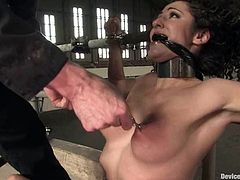 Hot brunette girl gets tied up and then toyed deep from behind. After that she also gets suspended and toyed again.