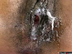 Attractive black girl Destiny Dane is penetrated in her hairy clam in a missionary position. She is banged hard until the guy cums onto her hairy pussy. He smears the cream all over her bearded clam.