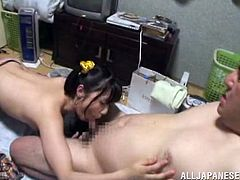 This lusty and dirty minded Japanese girl Tsubomi gives her dude a nice blowjob. It's quite strange that she gathers his cum in a condom!