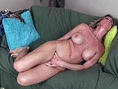 A dirty slut gets naked for the camera and performs an amazing solo scene where she fingers her pink wet snatch, check it out!