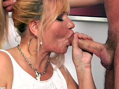Check out the way this old cunt grabs on to that pecker as if it was a sausage she's eating or something... anyway, check it out!