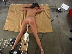 Cute dark-haired chick Tawny is having a good time indoors. She lies down on the floor and gets her vag smashed by a fucking machine.