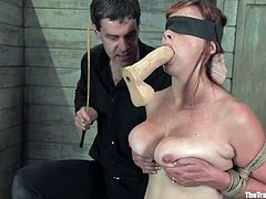 Busty redhead chick Bella Rossi is having fun with a guy named Maestro. The man ties and blindfolds the slut and then fucks her hot pussy from behind.
