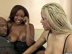 Sinnamon Love is sitting at home on the couch masturbating to a ebony porno mag. She calls up her best friend to come over with her black boyfriend so they all can have a threesome. When the white chick arrives the two girls take off the black guy's cock and give him a blowjob. They take turns sucking his bbc.