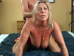 Take a look at this mature blonde's beautiful big natural tits as she gives a guy an amazing titty fuck before taking a pounding from it.