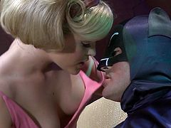 Batman and Robin are trying to apprehend the Riddler. His underground lair is below a go go club and Batman arrives and does the Batusi. One of Riddler's sexy henchwomen is turned on by Batman's dance and she sucks on his batpole.