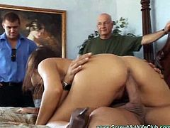 See an alluring brunette wife getting her hairy clam pounded into kingdom come in front of her husband.  He loves being cuckolded!