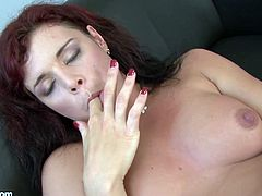 A horny redhead bitch inserts fingers in her cunt and then takes them to her mouth in this kinky solo scene, check it out right here!