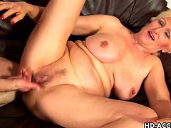 Come and check this vicious and busty blonde mature letting her man fist her pussy before making her tits bounce as he bangs that cookie into kingdom come.
