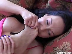 Rubbing her feet all over your cock