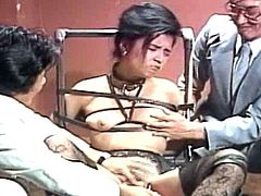 Horny japanese receives two cocks during amazing BDSM group session
