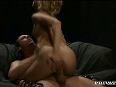 Petite blonde girl with perky tits takes her pink lingerie off and gives a blowjob. After that she lies down on a sofa and gets her tight pussy fucked. She also gets her mouth filled with sperm.