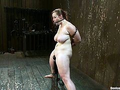 Bella Rossi is the voluptuous redhead getting dominated, toyed and tit tortured in this BDSM porn video with some pretty wild stuff going on.