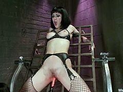 Kinky brunette Asphyxia Noir is getting naughty with bosomy dominatrix Isis Love in a basement. Isis binds her slave, attaches wires to her body and then pounds her juicy snatch with toys.